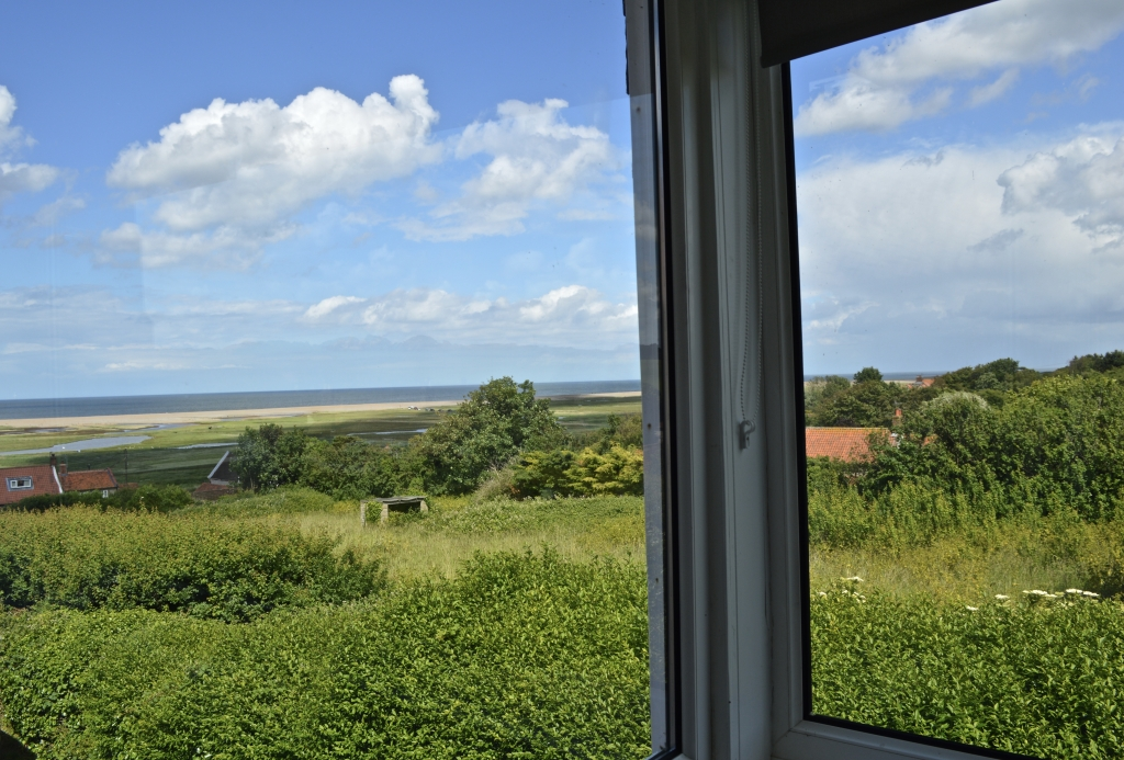 The View from the sitting room at St Nicholas Cottage, overlooking the salt marsh and sea